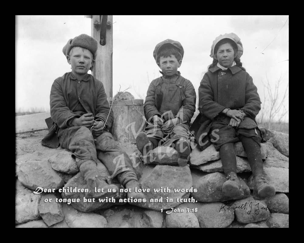 Three kids sitting on Rocks